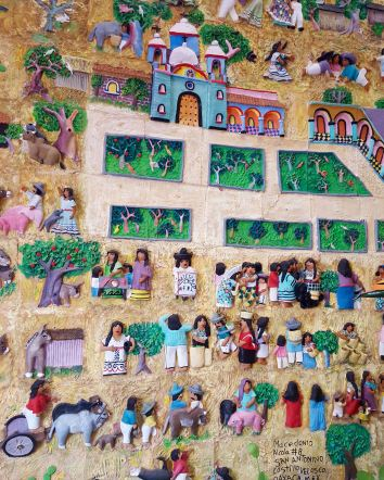 Scene of a town, ceramic tiles assembled in place in foyer of Casa del Venado